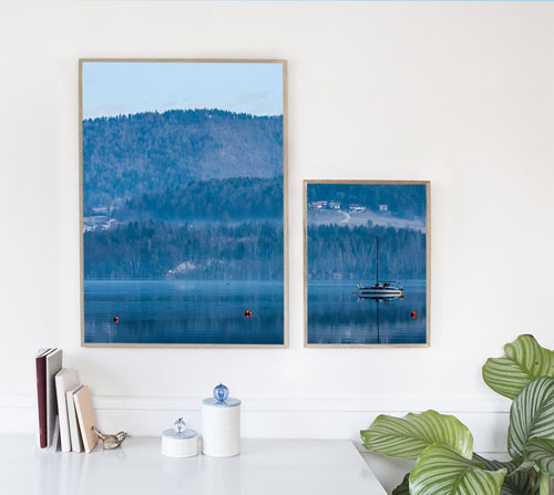 Frames on the wall with a Velenje lake and boat