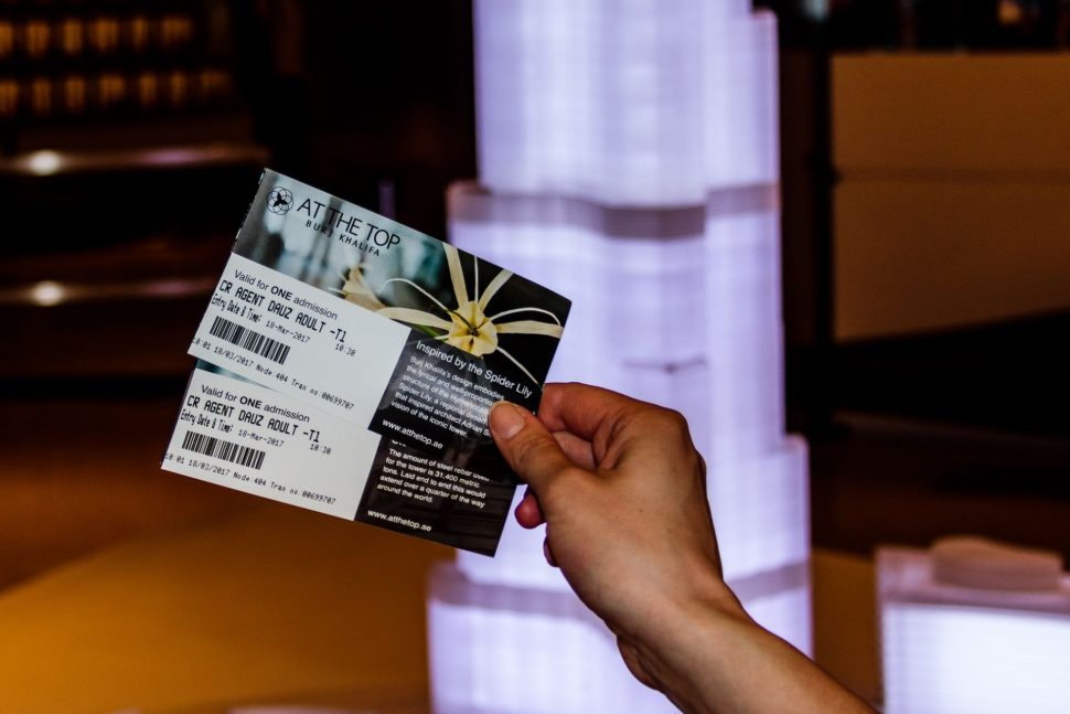hand with tickets to At the Top Burj Khalifa Dubai