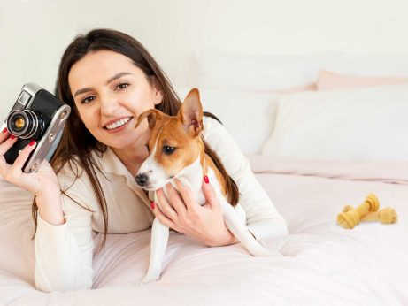 Woman with camera and a dog for article Pets photography tutorial
