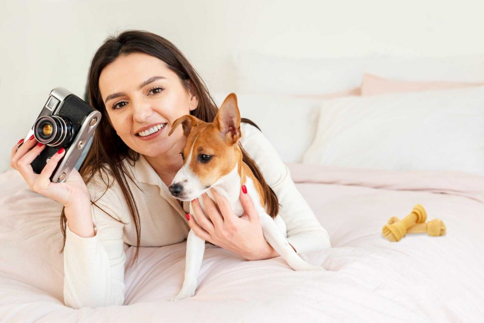 Woman with camera and adog for article Pets photography tutorial